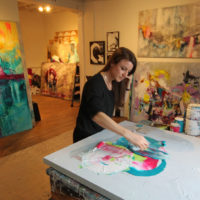 Artist Sarah Phelps painting in her studio