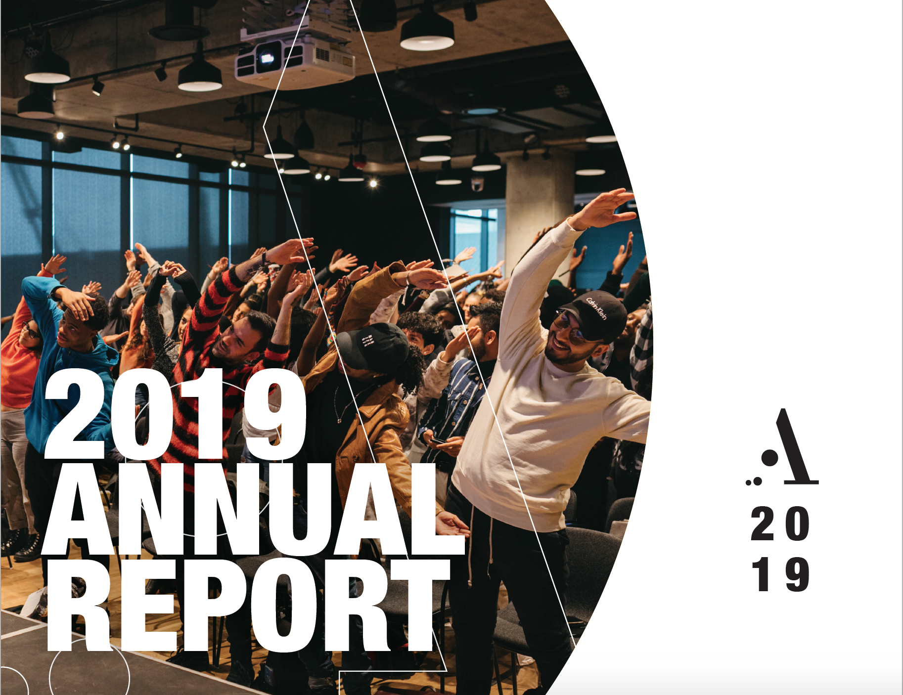 "Group of people in a room doing standing stretches in unison. Text overlay on bottom left reads ""2019 ANNUAL REPORT"" in white block text. Right side of image: white background, Artscape logo/""2019"" on bottom right in black."